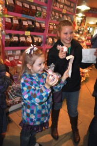 Showing their candy treasures.