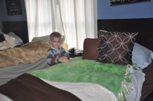 Zeke making my bed.
